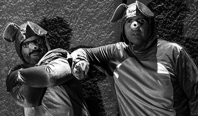 The two Jamies in dog costumes for Blind Ambition