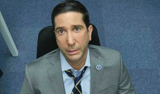 Schwimmer in Intelligence, sitting on office chair