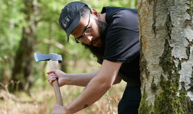 Jamali on Outsiders attacking tree with an axe