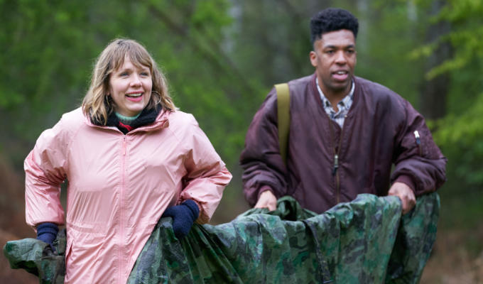Kerry and Toussaint on Outsiders, carrying a canvas stretcher
