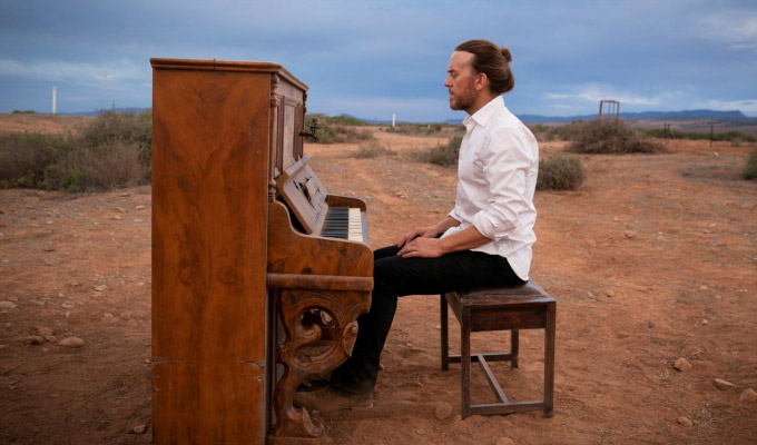 The piano is a cross he's bearing for his sins... | Tim Minchin on his new series Upright