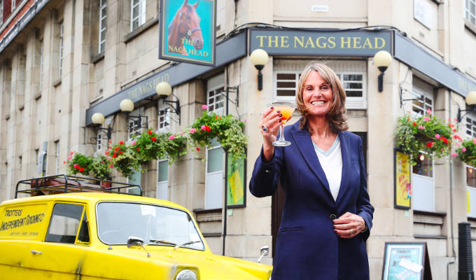 Gwyneth outside the pub with Del Boy's Robin Regal